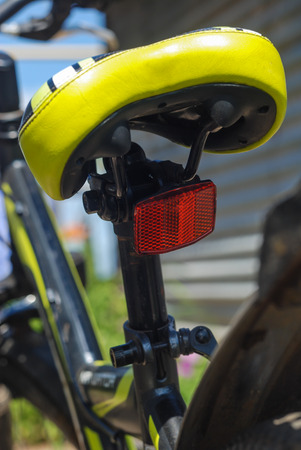 reflector: safety reflector under a cycle saddle Stock Photo