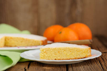 clementine: Cut clementine pie with clementines on wooden background closeup macro