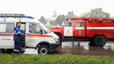 Orel, Russia, August 29, 2017: Collapse of old apartment house. Red fire truck and ambulance car at catastrophe site horizontal