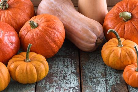 Bright orange pumpkins as symbol of Halloween on blue wooden table copyspace closeup Stock Photo