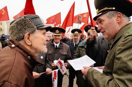 Orel, Russia, November 7, 2017: October Revolution anniversary meeting. Senior man talking to official closeup