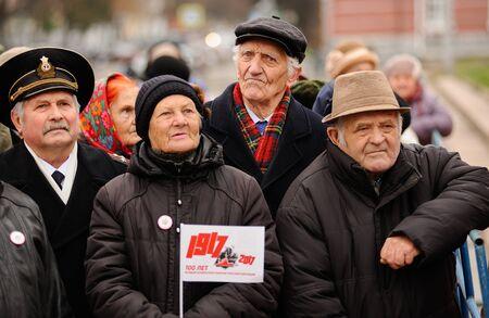 soviet flag: Orel, Russia, November 7, 2017: October Revolution anniversary meeting. Sad senior people in dark clothes with 1917 sign flag Editorial