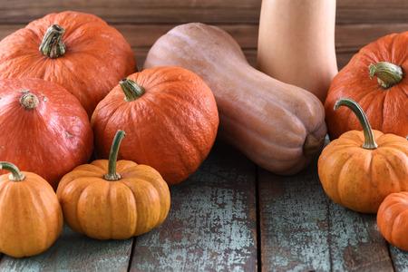 Thanksgiving, Harvest festival bright orange pumpkins on old blue wooden background closeup Stock Photo