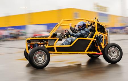 Orel, Russia, July 22, 2017: Dynamica car festival. Man in helmet riding buggy car blurred Editorial