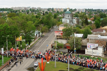 Orel, Russia - May 9, 2017: Victory Day selebration. Large crowd of people marching in Immortal Regiment viewed from bird view