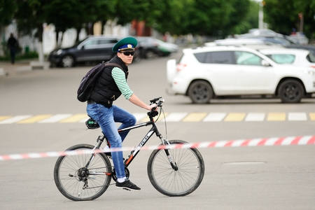 Orel, Russia - May 28, 2017: Bikeday. Bicyclist riding alone stop tape on street