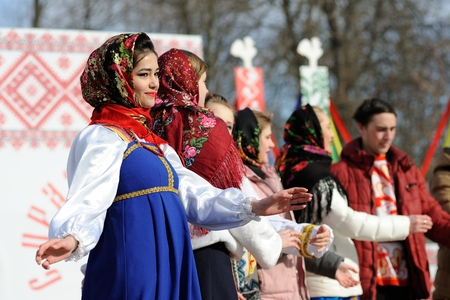 Orel, Russia - February 26, 2017: Maslenitsa fest. Girls in Russan sarafans and shawls singing closeup