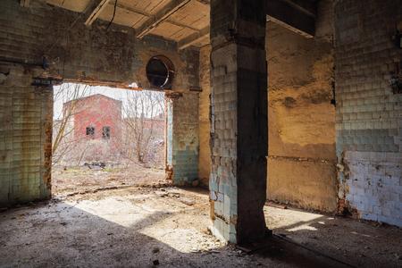 Abandoned Soviet Construction With Brick Columns At Sunny Day Interior  Stock Photo   90938129
