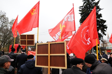 Orel, Russia - November 07, 2016: Communist meeting. People in black with red banners backside Editorial