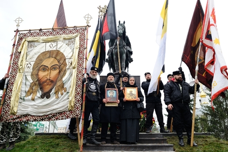 Orel, Russia - October 14, 2016: Ivan the Terrible monument opening ceremony. Orthodox Banner-Bearers with Jesus Christ icon infront the monument