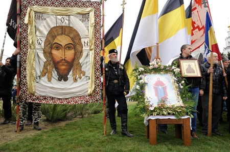 Orel, Russia - October 14, 2016: Ivan the Terrible monument opening ceremony. Russian ultra-orthodox clerical group with Russian Empire Christ banners and orthodox icons with Jesus Christ Editorial