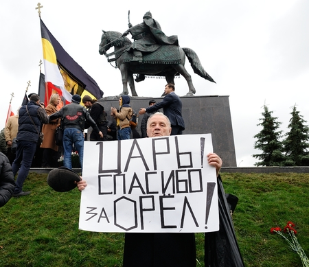 Orel, Russia - October 14, 2016: Ivan the Terrible monument opening ceremony. Ivan the Terrible monument and man with banner: Tsar! Thank you for Orel closeup Editorial