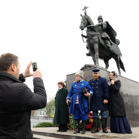 Orel, Russia - October 14, 2016: Ivan the Terrible monument opening ceremony. People in cossack uniforms posing for photo with Ivan the Terrible monument beside