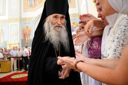 Orel, Russia - July 28, 2016: Russia baptism anniversary Divine Lutirgy. Starets Iliya, Putins duhovnik, orthodox Christian monk  blessing parishioners closeup