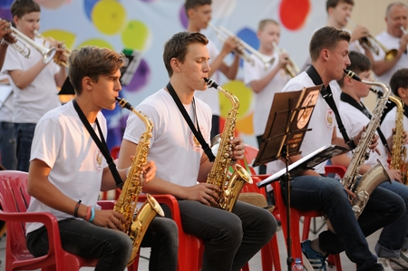 Orel, Russia - August 05, 2016: Orel city day. Young musicians playing in orchestra horizontal