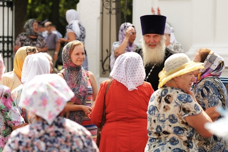 Orel, Russia - July 28, 2016: Russia baptism anniversary Divine Liturgy. Senior monk blessing women at church garden Editorial