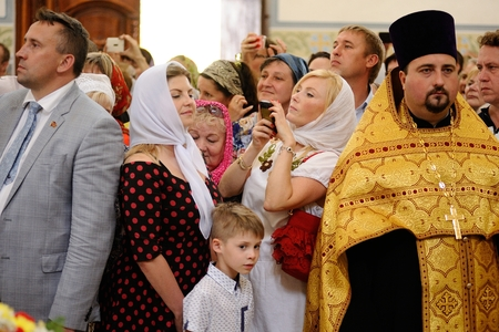 Orel, Russia - July 28, 2016: Russia baptism anniversary Divine Liturgy. Woman making selfie in church horizontal