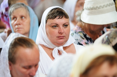 Orel, Russia - July 28, 2016: Russia baptism anniversary Divine Lutirgy. Woman parisioner in white kerchief closeup