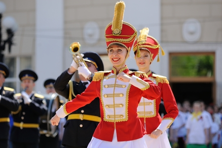 Orel, Russia - May 9, 2016: Celebration of 71th anniversary of the Victory Day (WWII). Hussars dressing dancers and military brass band Editorial