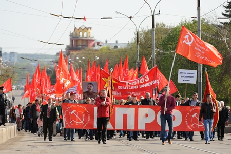 Orel, Russia - May 1, 2016: Communist party demonstration. Crowd of people with red Soviet flags horizontal