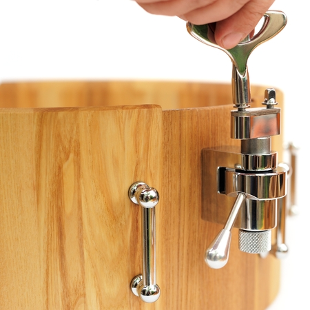 Master tuning new wooden snare drum isolated closeup closeup Stock Photo