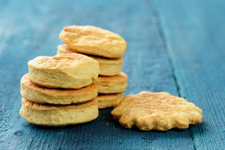 Tasty round homemade cookies on deep blue background closeup