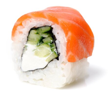 Filadelfia roll with salmon, rice, cucumber and cream cheese isolated closeup