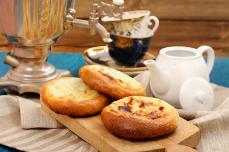 Vatrushka, Russian pastry with cottage cheese served with samovar and tea horizontal