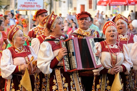 Orel, Russia, August 4, 2015: Orlovskaya Mozaika folk festival, men playing accordion and women in Russian traditional suits horizontal