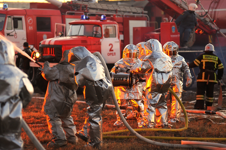 Orel, Russia - December 09, 2015: Emergency Control Ministry (MCHS) tactical exercise. Firemen with fire engines fighting fire  horizontal Éditoriale