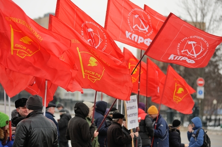 Orel, Russia - December 05, 2015: Truck drivers picket. Crowd of people with red communist flags closeup Editorial