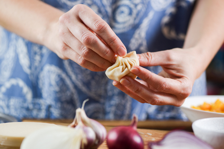 Woman making traditional Nepalese dumplings momos closeup
