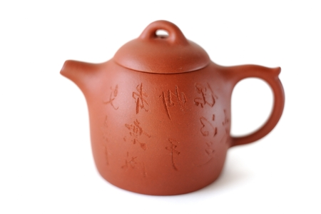 Chinese Yixing clay tea pot  with inscription: Wen Zhang Ben Tian Cheng, Miao Shou Ou De Zhi (get something by chance with a highly  skill) isolated 스톡 콘텐츠 - 92392201