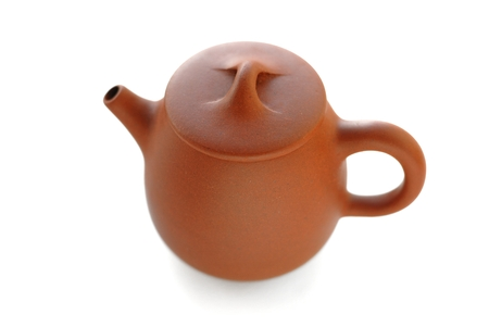 Yixing red clay teapot top view isolated 版權商用圖片