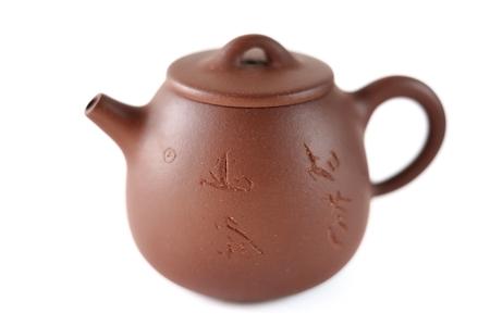 Chinese Yixing clay tea pot with insription: Zhou Ting Shou Zhi isolated
