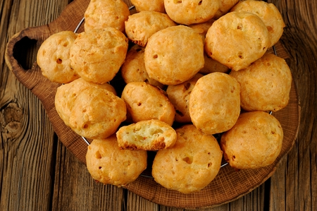 Gougeres on wood board with wooden background Stock Photo