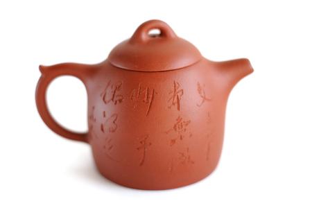 Chinese Yixing clay tea pot  with inscription: Wen Zhang Ben Tian Cheng, Miao Shou Ou De Zhi (get something by chance with a highly   skill)