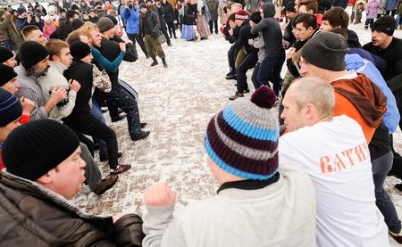 Orel, Russia, February 18, 2018: Maslenitsa carnival. Men fighting stenka na stenku martial art panorama Editorial