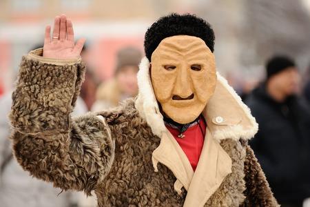 Orel, Russia, February 18, 2018: Maslenitsa carnival. Man in scary mask saluting closeup