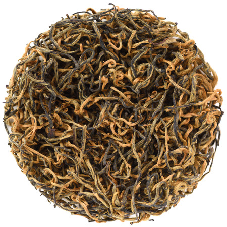 Simao Spring Tips Red Tea from Yunnan round shape isolated