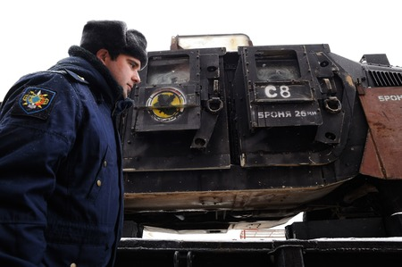 Orel, Russia, February 25, 2019: Syrian Break - trophy exhibition train of Russian Defence Ministry. Military man in uniform at armored Syrian machinery closeup