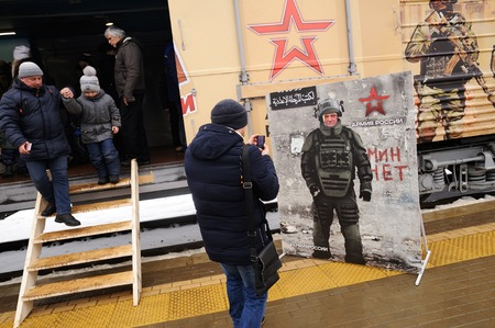 Orel, Russia, February 25, 2019: Syrian Break - trophy exhibition train of Russian Defence Ministry. People coming out of exhibition wagon and taking photos stand-in