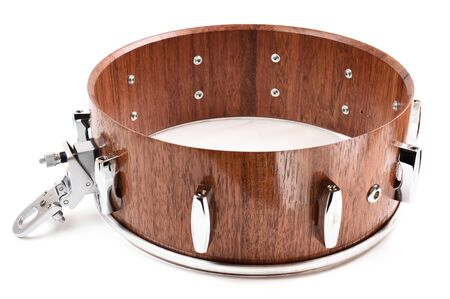 Percussion musical instrument. Making snare drum of merbau wood isolated on white background overhead view