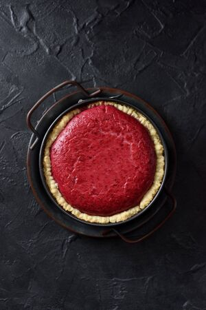 Homemade Nordic lingonberry pie in vintage metal tray on black background top view copy space Stock Photo