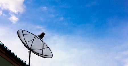satelite: Satelite dish and blue sky background.