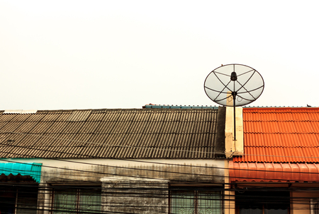 satelite: satelite dish on the roof and cloud sky background.