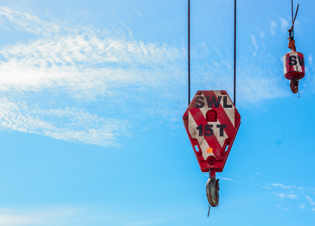 crane: Hooks crane and blue sky background. Stock Photo