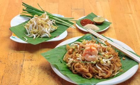 garnish: Thai noodle or padthai,garnish,vegetable,shrimp and blur background.