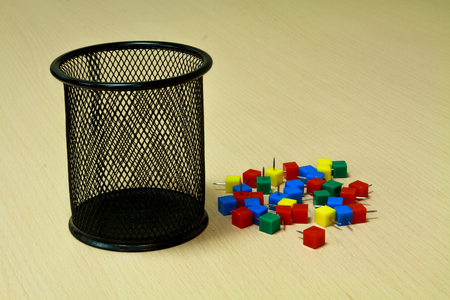 tack: Paper tack and black basket on the wood background. Stock Photo