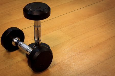wood floor background: Dumbbells on the wood background and vignetting.